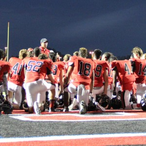 Coppell High Schools JV Red team comes together during halftime Sept. 24 at Buddy Echols Field. The Cowboys defeated L.D. Bell 31-0.