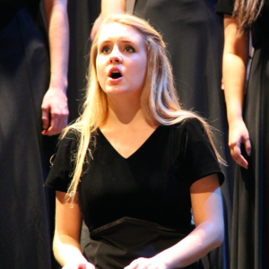 """Coppell High School sophomore Amelia Vanyo performs during the fall choir show on Oct. 8. in the CHS auditorium. Vanyo is in the Kantorei group that performed """"Turn Around"""" and """"There Will Come Soft Rain""""."""