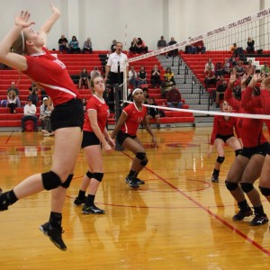 Coppell High School junior Katie Herklotz prepares to hit over the net on the right side.The Cowgirls won all three sets, the first with a score of 25-9, 25-17, and 25-11 on Friday night's game in the CHS large gym. Photo by Megan Winkle.
