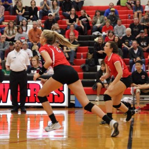 Coppell High School senior Kylie Hagen-Breitenwischer runs to cover the floor along with other varsity players. The Cowgirls won all three sets, the first with a score of 25-9, 25-17, and 25-11 on Friday night's game in the CHS large gym. Photo by Megan Winkle.