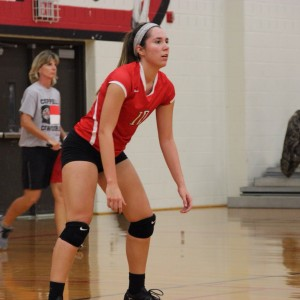 Coppell High School senior Caroline Riley anticipates the ball on Friday night's game in the CHS large gym. The Cowgirls won all three sets, the first with a score of 25-9, 25-17, and 25-11. Photo by Megan Winkle.