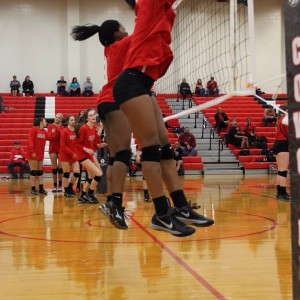 Coppell High School freshman Mykayla Myers warms up blocking before the big game against Trinity High School. The Cowgirls won all three sets, the first with a score of 25-9, 25-17, and 25-11 on Friday night's game in the CHS large gym. Photo by Megan Winkle.