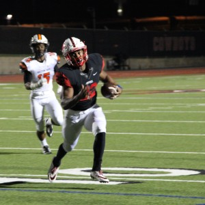 Coppell High School senior running back Brandon Rice runs the ball into the endzone scoring a touchdown for the Cowboys. Coppell High beat Haltom 44-6 Friday night at Buddy Echols Field. Photo by Megan Winkle