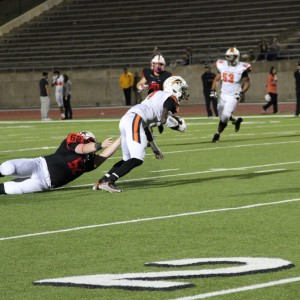 Coppell High School senior defensive lineman Frankie Morgan attempts to tackle Haltom ball carrier. Coppell beat Haltom 44-6 at Buddy Echols Field on Friday night. Photo by Megan Winkle