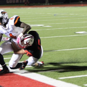 Coppell High School senior defensive back Mason Junker tackles a Haltom player and goes out of bounds on Buddy Echols Field. The Buffalos lost to the Cowboys on Friday night 44-6. Photo by Megan Winkle