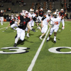 Coppell High School junior running back Joe Fex runs the ball on offense across Buddy Echols Field. Coppell defeated Haltom Friday night 44-6. Photo by Megan Winkle