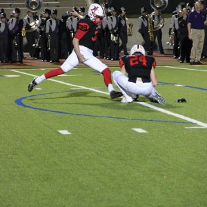 Coppell High School senior kicker Tyler Smith kicks a field goal as the first quarter comes to a close extending the score to 38-6. The Cowboys beat the Buffalos 44-6 Friday night at Buddy Echols Field. Photo by Megan Winkle