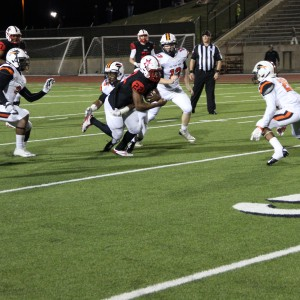 Coppell High School senior running back Brandon Rice runs the ball on offense during the second quarter. The Cowboys beat the Buffalos Friday night at Buddy Echols Field 44-6. Photo by Megan Winkle