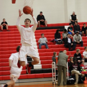 Coppell High School senior guard K.J. Luenser warms up his jump shot before the game against Mansfield Timberview. The Cowboys beat the Wolves Friday at home in the large gym 54-52.