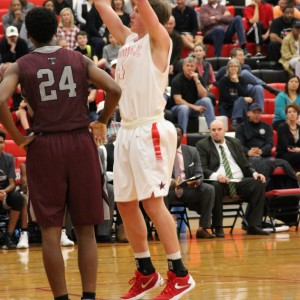 Coppell High School junior forward Sam Marshall shoots a free throw during the home game Friday night. The Cowboys beat the Wolves 54-52.