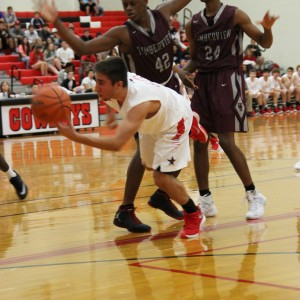 Coppell High School senior guard Alex Vuchkov is double blocked by Mansfield Timberview players. The Cowboys beat the Wolves Friday at home in the large gym 54-52.