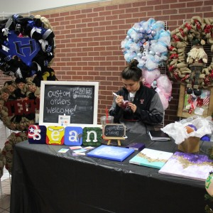 Texas Tech student Nicole Hragyil decorates an ornament on Nov. 15 at the Coppell Holiday House at Coppell High School. She decorates and sells seasonal wreaths and ornaments on her etsy store. Photo by Jennifer Su.