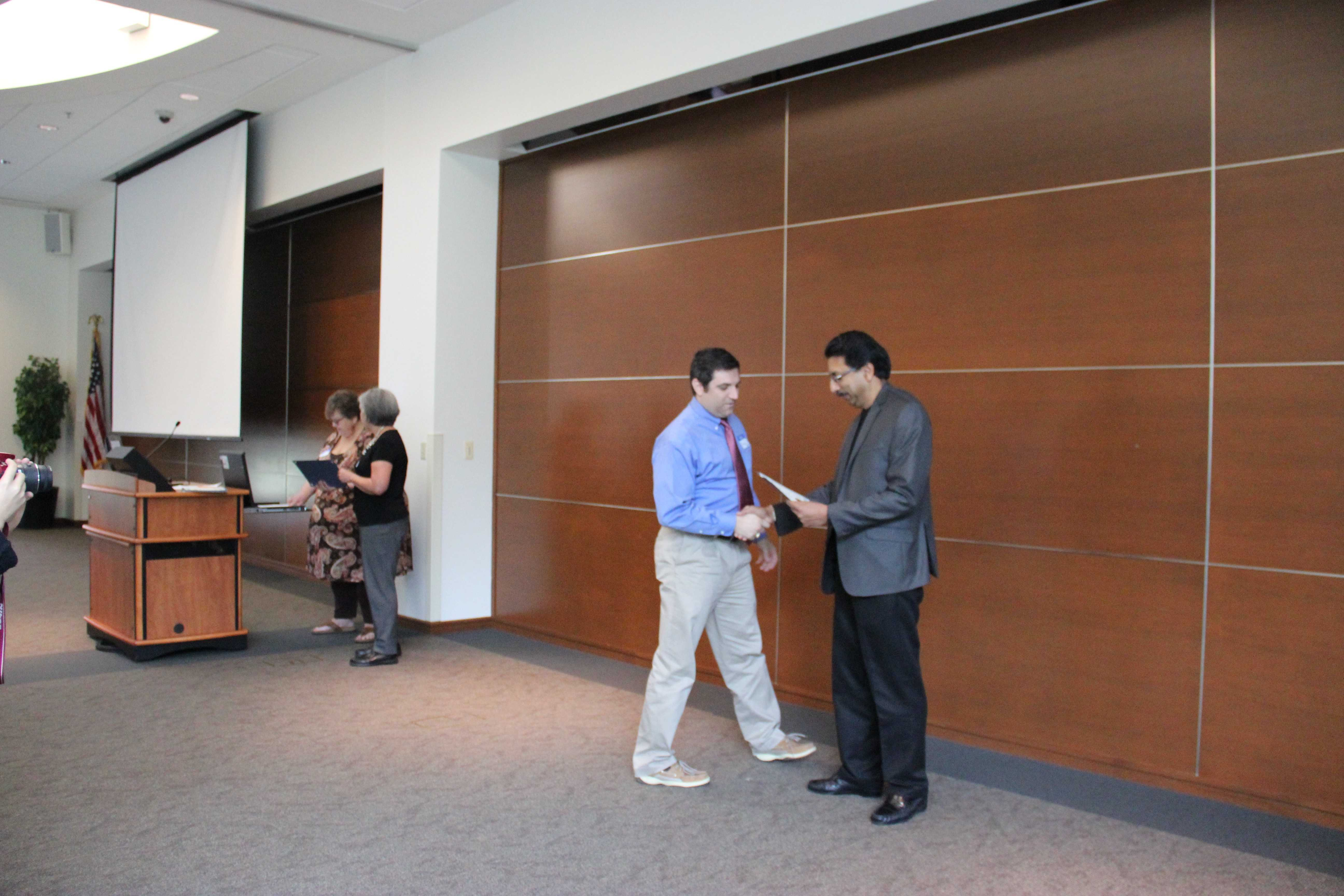 Coppell High School engineering teacher Grant Garner receives recognition for the University of Texas at Dallas 2015 Inspiration Award by motivating and inspiring future computer scientists. This award was presented by UTD Computer Science department head Dr. Gopal Gupta.