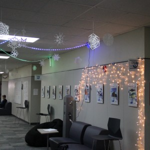 Coppell High School senior IB students Saman Hemani and Lea Balcerzal put up snowflakes and lights down the IB hallway on Monday. They both contributed lots of time and effort to show the Christmas spirit.