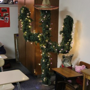 Coppell High School Pre-AP Spanish II teacher Judy Garrett puts up lights around a cactus in her classroom.
