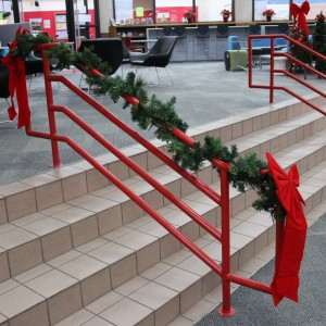 Coppell High School library teachers put up decorations around the staircase railings during the holidays. With Christmas break approaching, the library is spreading cheer and bettering the holidays.