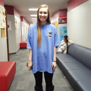 Coppell High School junior Autumn Jones dresses in leggings and an oversized t-shirt, a trend at CHS. Jones is a member of KCBY and is representing the program on her t-shirt. Photo by Jamie Kimbrell.